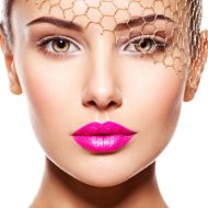 Fashion portrait of a beautiful  girl wears golden veil on face. pink lips. Isolated on white background
