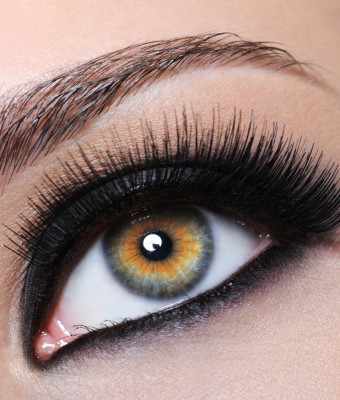 Female eye with bright black make-up and long eyelashes